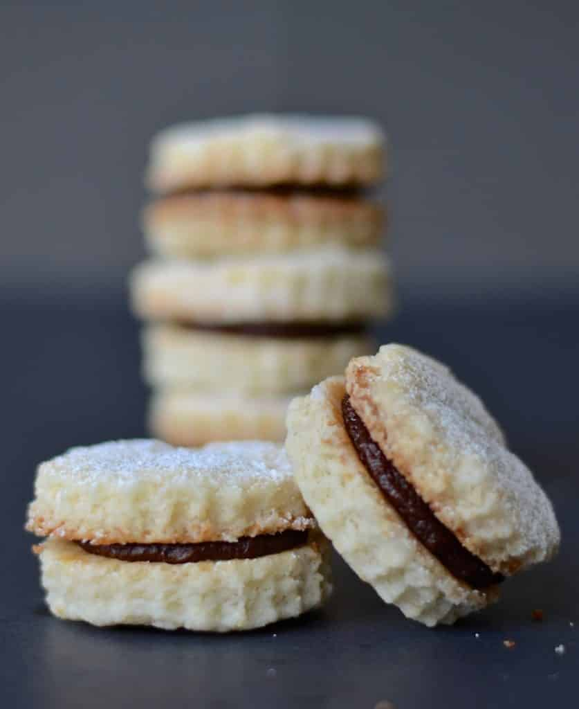 Melt in the mouth Vegan Coconut Cookies with Chocolate Cream. Beautifully short morsels of deliciousness!
