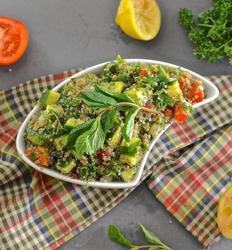 This Quinoa Tabbouleh is a breeze to throw together & combines beautiful, fresh & vibrant flavours. It is just one of many delicious recipes in Dining At The Ravens by Jeff & Joan Stanford.
