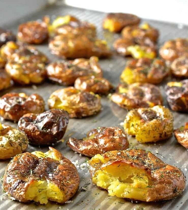 Take the humble potato to a whole new level with these extra crispy Dilly Smashed Baby Potatoes. Roasted, smashed, then roasted some more, their golden nubbliness is just irresistible. Serve them dripping in my mild & creamy horseradish sauce. Potato perfection.....