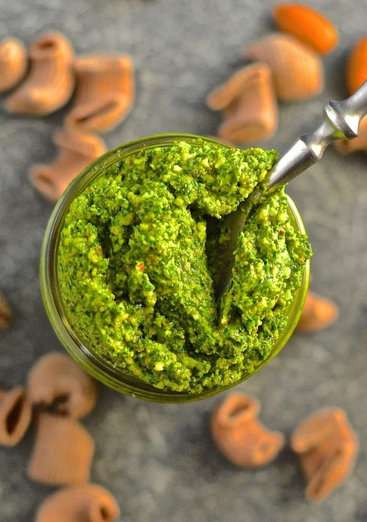 Kale Almond Vegan Pesto in a jar with a spoon in, taken from above