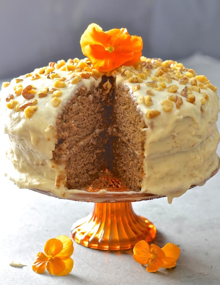 Tender, moist nutty sponge sandwiched together with creamy maple infused frosting. Completely dairy, egg & oil free but perfectly sweet & decadent, this maple walnut cake is total perfection!