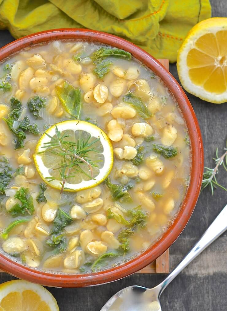 Lemon Kale and White Bean Stew in a terracotta bowl