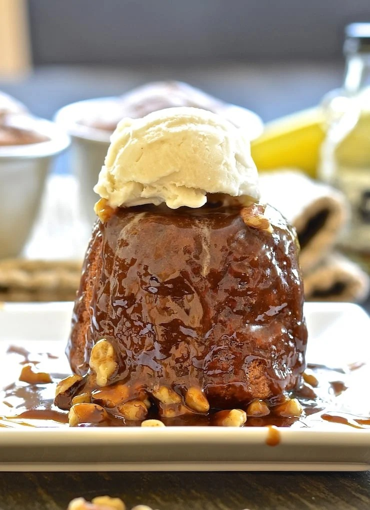 Sticky Banana Date Pudding drizzled in rum caramel and topped with vanilla ice cream