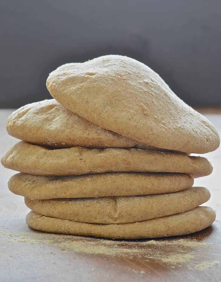 a stack of fluffy homemade pita bread
