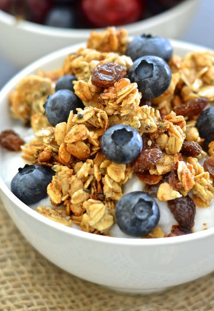 Close up shot of Vegan Almond Hemp Granola with fresh blueberries