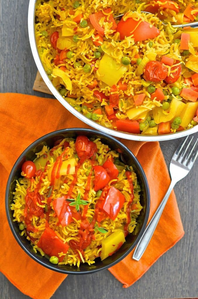 This One-Pot Spicy Vegetable Rice is our go to favourite mid-week dinner. 3o minutes & one pot is all that is standing between you & a big bowl full of deliciously spiced, flavourful rice studded with sweet, soft veggies.