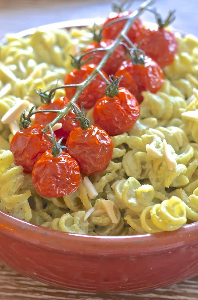 A simple but incredibly delicious, super creamy Vegan Pesto Pasta Salad topped with juicy, sweet, oven roasted tomatoes. It has just 5 ingredients & is ready in the time it takes to roast the tomatoes!