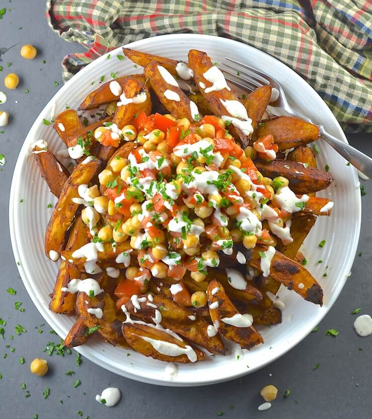 Loaded taco fries with drizzles of tasty crema!