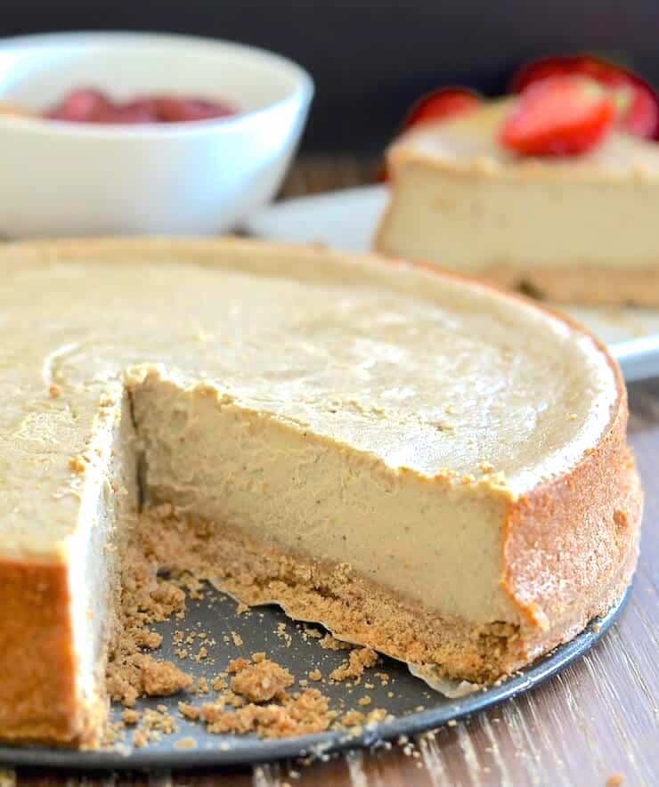 A Baked Vegan New York Cheesecake with a slice taken out