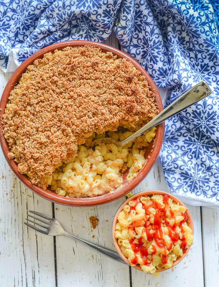 Meltingly soft vegan mac and cheese topped with buttery, crispy, golden crumb topping