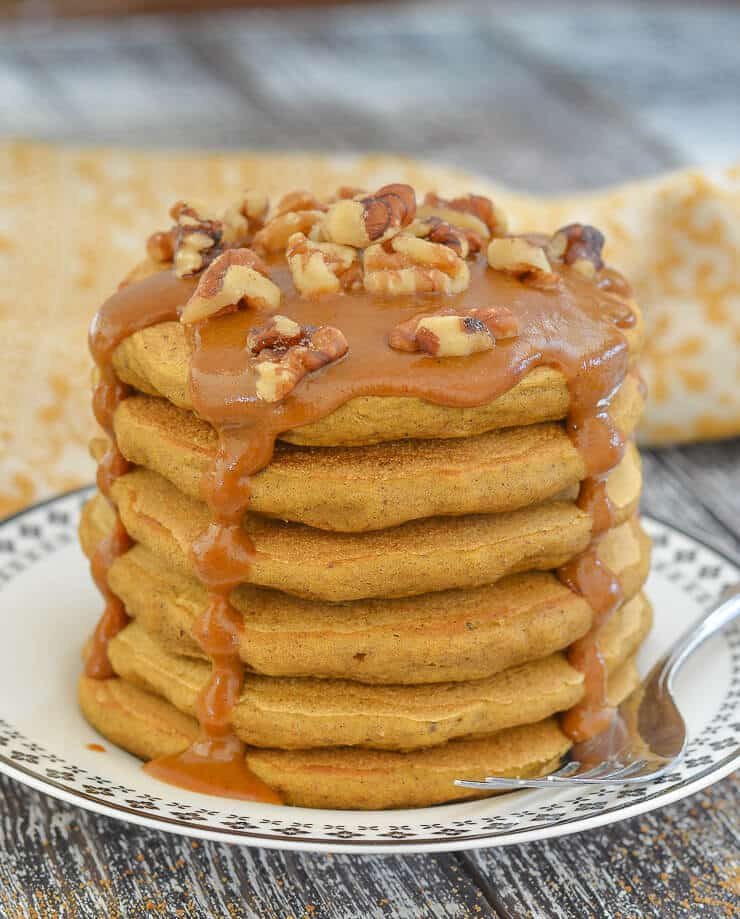 Vegan Sweet Potato Pancakes stacked and drizzled in THE most delicious Caramel Sauce.