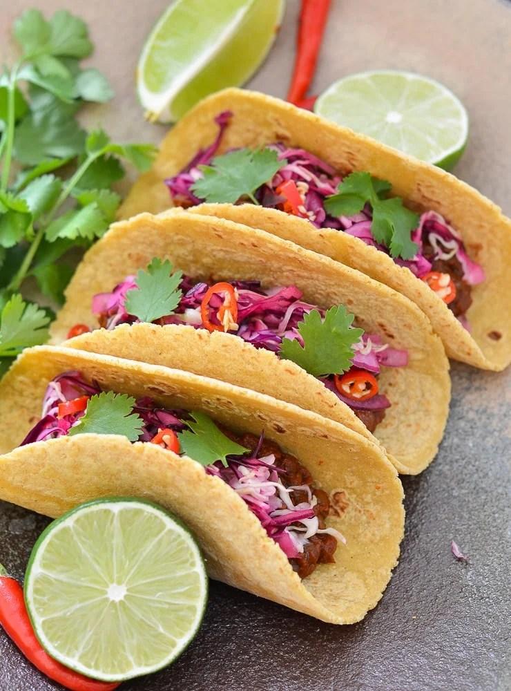 Enchilada Lentil Taco topped with zesty lime slaw.