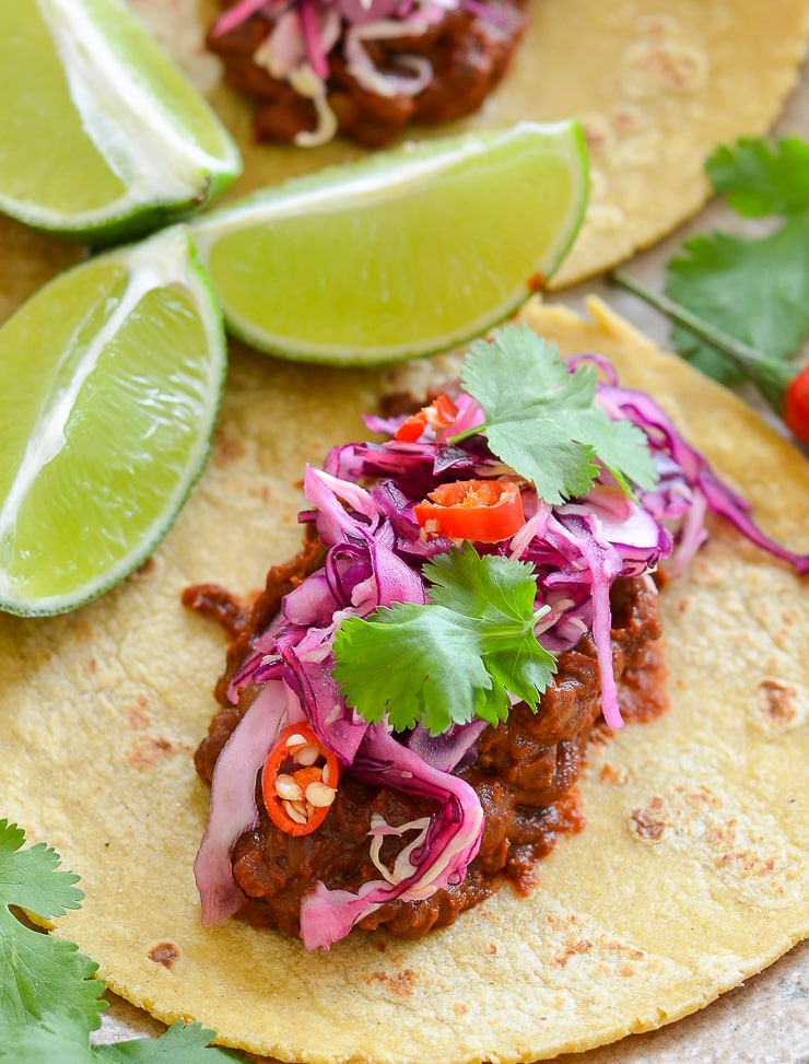 Enchilada Lentil Tacos topped with zesty and pretty in pink lime slaw. They taste as good as they look!