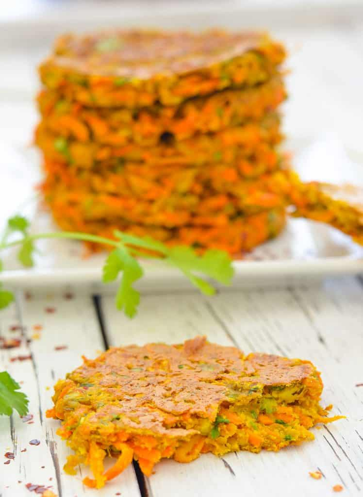 Interior shot of Curried Carrot Fritters with stack of fritters in the background