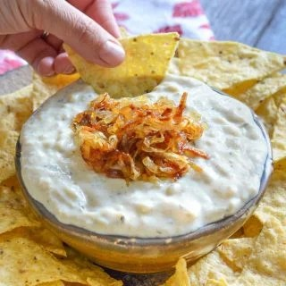 A deliciously cool, creamy & nut-free vegan Onion Garlic Dip. Full of sweet roasted garlic & caramelized onion flavour & perfect for your next party!
