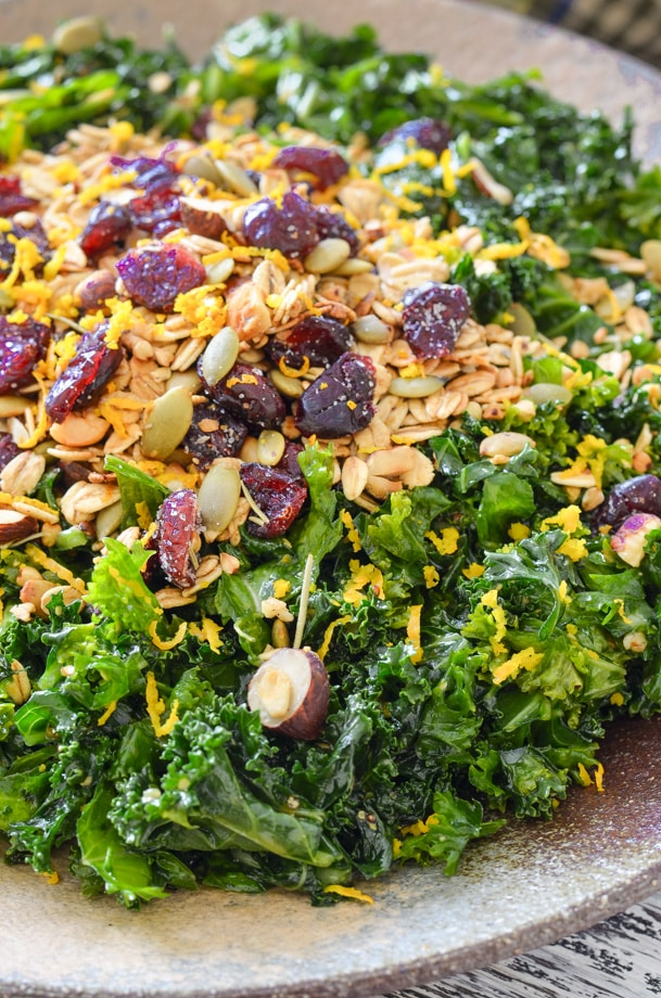 close up shot of massaged kale salad with nutty, crispy, crumbly savoury granola