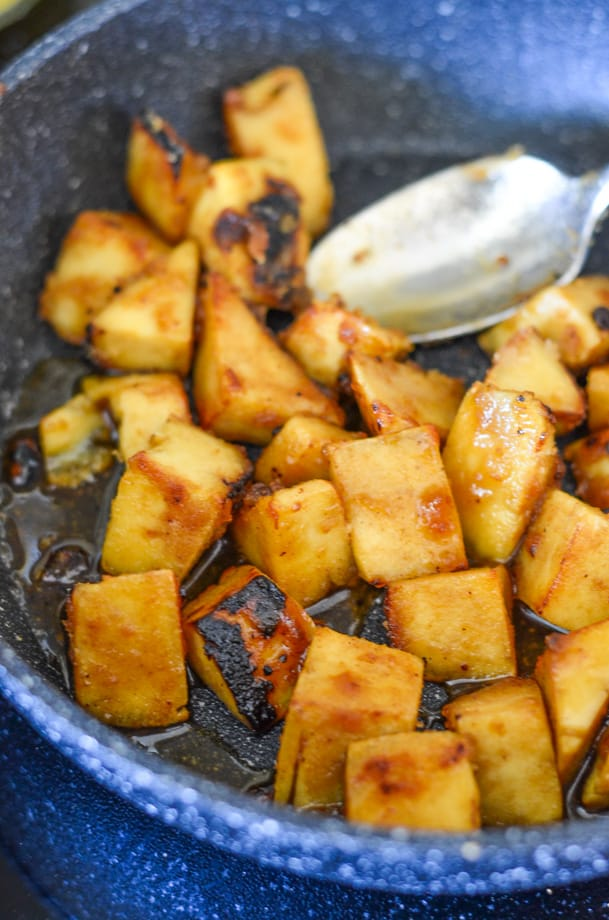 Sticky Coconut Lime Pan-Fried Tofu cooking in a pan