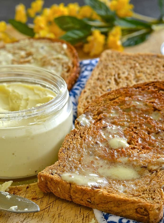 Easy vegan butter spread on warm toast. Melty and drippy.