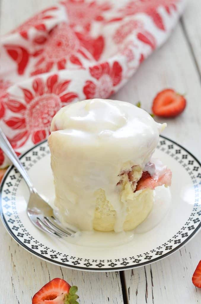 Strawberry Sweet Roll Vegan Mug Cake on a plate with white frosting