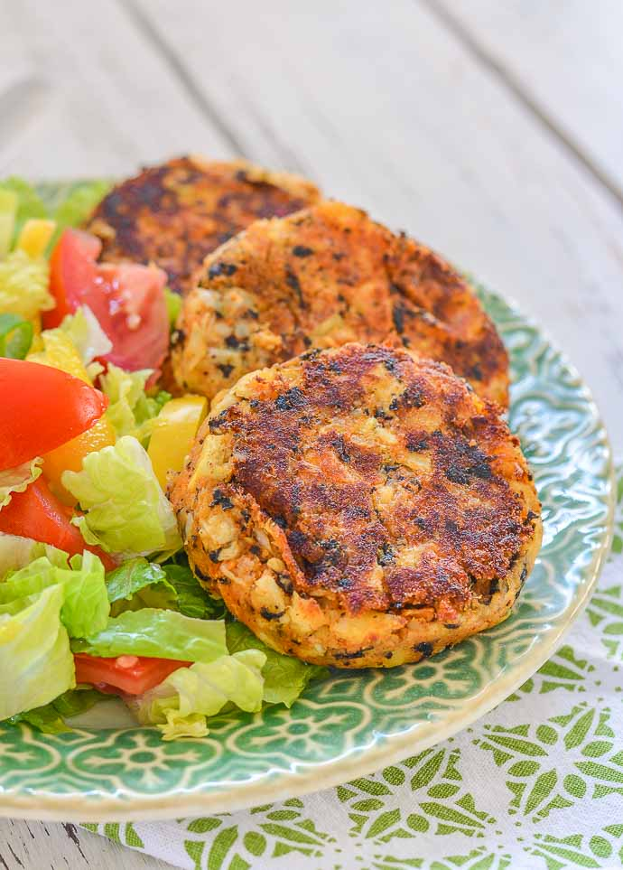 3 Thai Style Vegan Crab Cakes on a pretty plate with salad