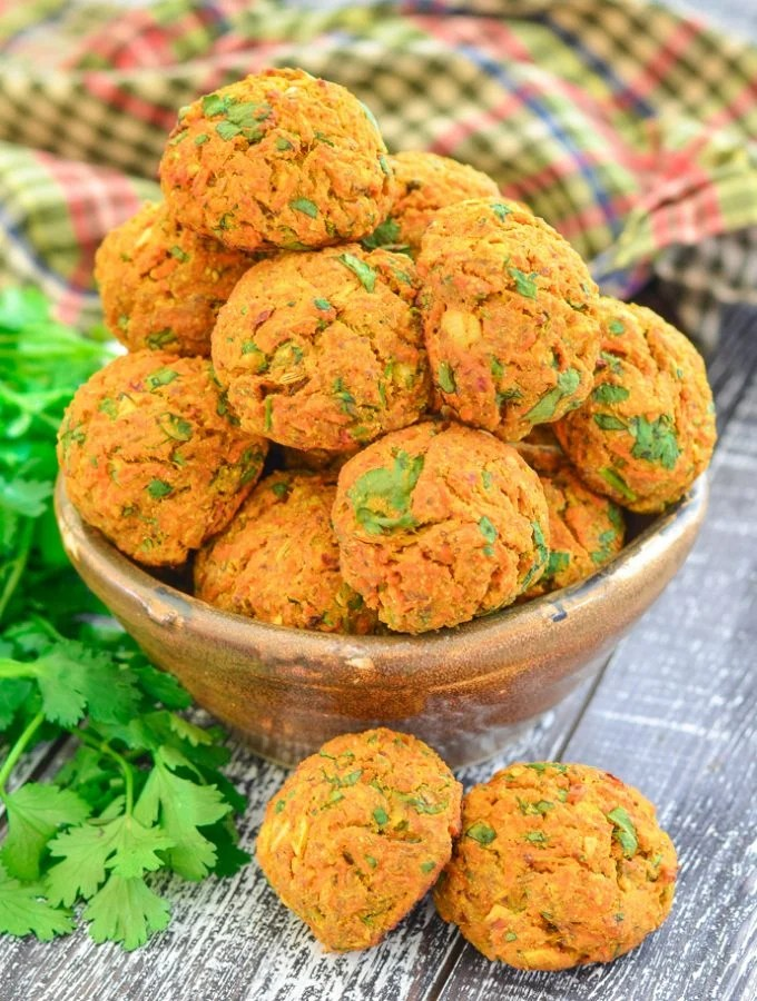 Curried Carrot Baked Falafel in bowl with cilantro