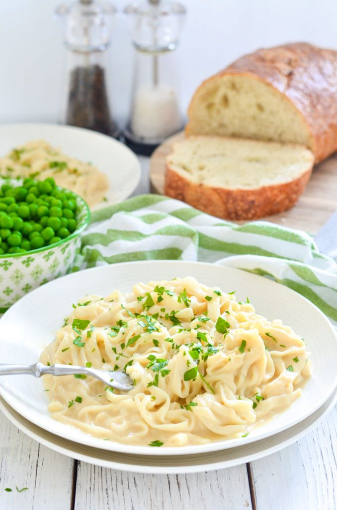 Skinny Fettuccine Cauliflower Alfredo scattered with parsley on a plate