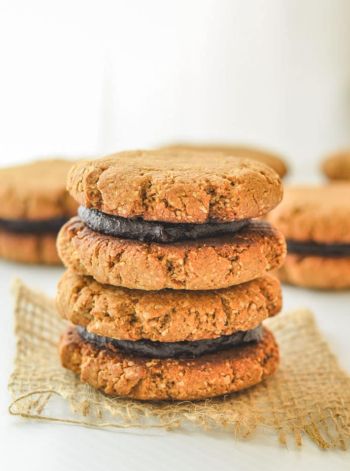 Healthy Pumpkin Ginger Date Cookies sandwiched together with rich chocolate cream
