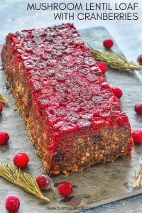A fresh take on a Vegan Lentil Loaf for you! It's made with a delicious blend of lentils, mushrooms and walnuts and has a beautifully festive cranberry topping. Those pops of juicy cranberry in every bite are so good, plus they make it look pretty impressive. It would make a great centrepiece on your holiday table!
