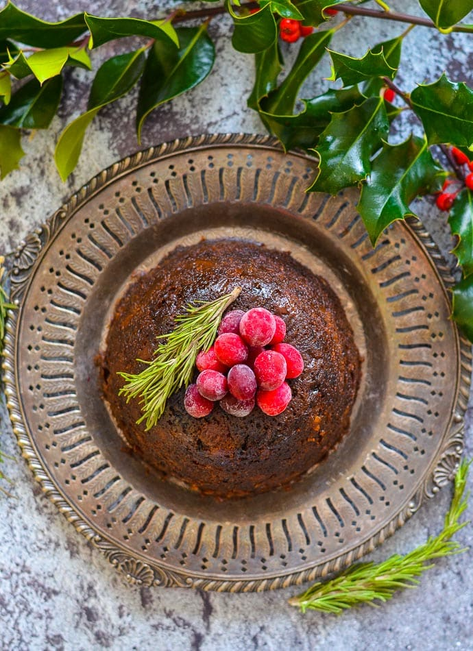 Vegan Christmas Pudding on bronze metal plate, shot taken from above
