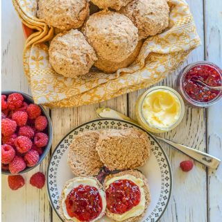 A bowl of Healthy Vegan Biscuits & a couple on a plate, split with butter & jam