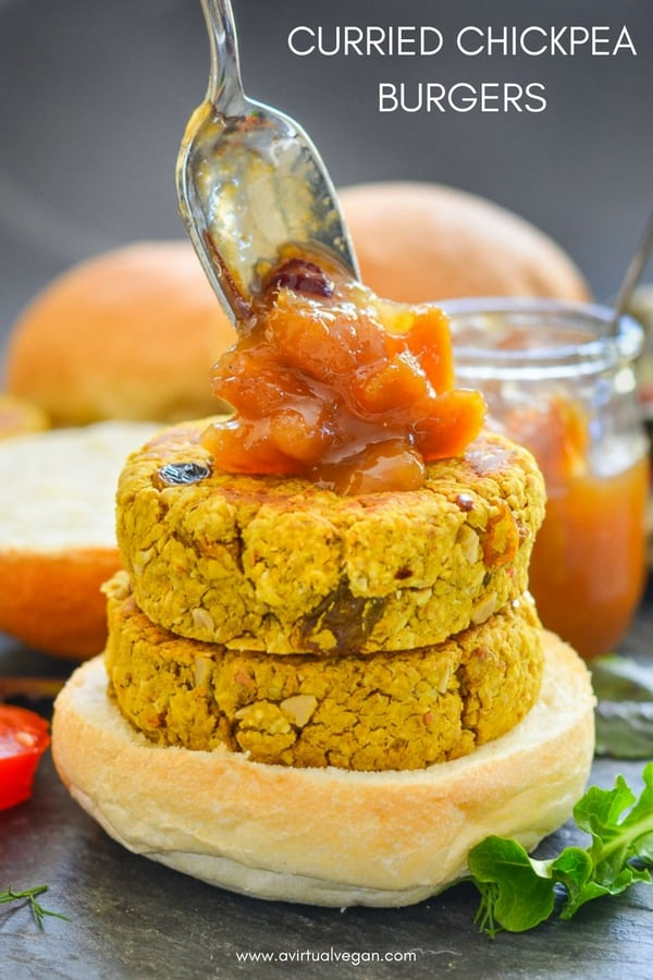 Quick & easy Curried Chickpea Burgers. They are full of curry flavour with bursts of sweetness from plump golden raisins and texture from chopped cashew nuts & chewy oats. Serve them in buns with a generous dollop of mango chutney!