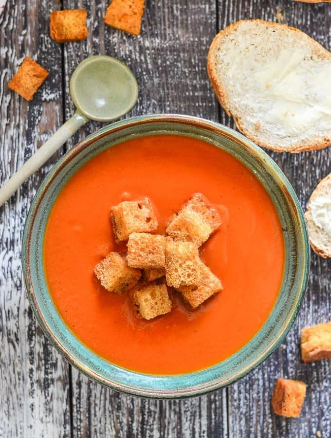 A bowl of Instant Pot Tomato Soup topped with golden croutons