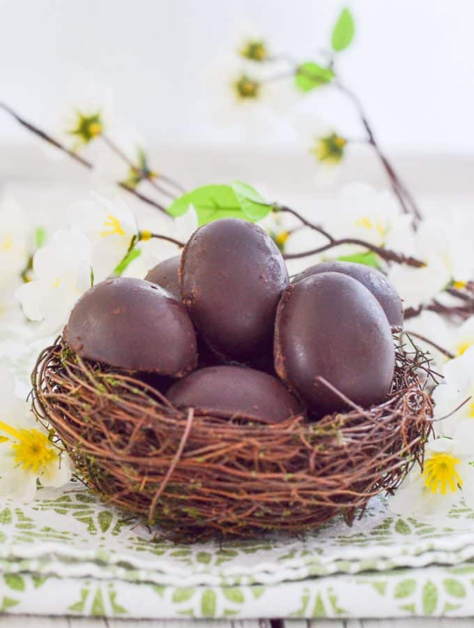 Vegan Caramel Eggs nestled in a faux bird's nest