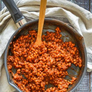 a skillet of sticky BBQ baked beans