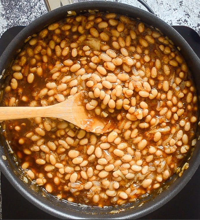 BBQ Baked Beans being cooked in a skillet