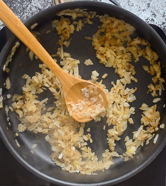 onions browning in a skillet