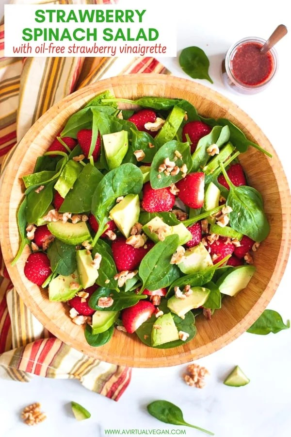 A simple, super tasty Strawberry Spinach Salad made with iron rich spinach, juicy strawberries, creamy avocado & crunchy nuts, then finished off with a fresh, oil-free, strawberry vinaigrette.