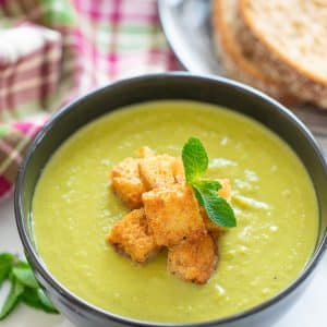 A bowl of brilliant green goodness to warm your soul! This Green Pea Soup with a generous handful of mint for good measure, is healthy, low calorie, packed with protein and super simple to make. With only 6 ingredients (plus salt & pepper) you probably already have everything you need to make it too!