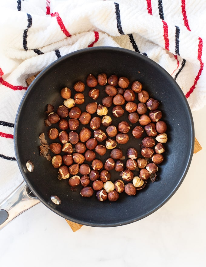 hazelnuts toasting in a pan