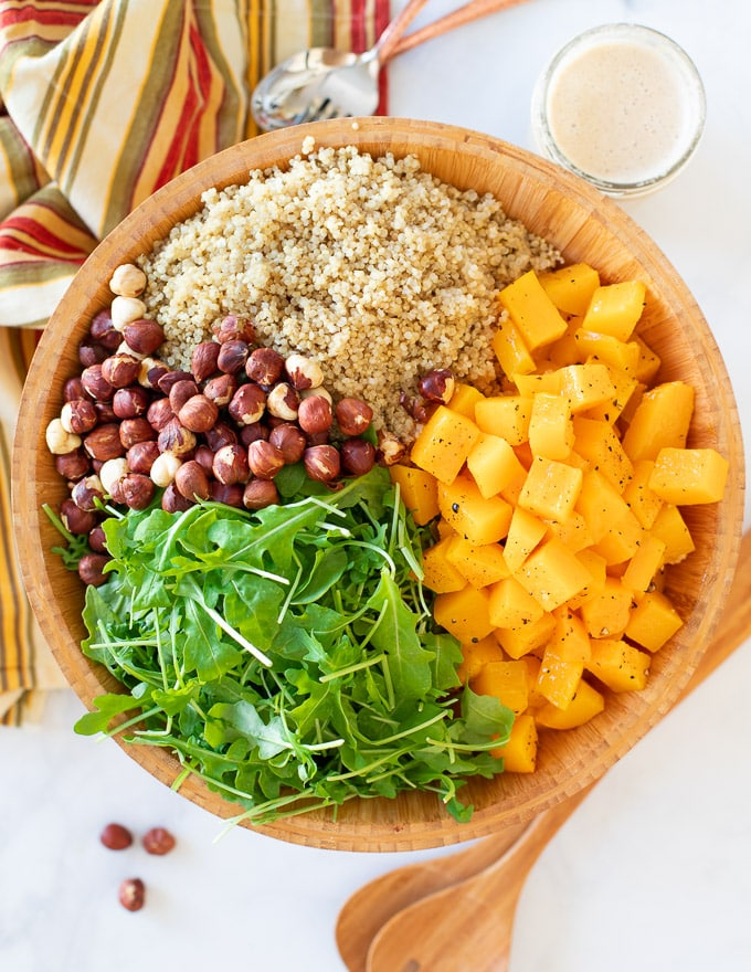 A large salad bowl full of Fall Harvest Butternut Squash Salad