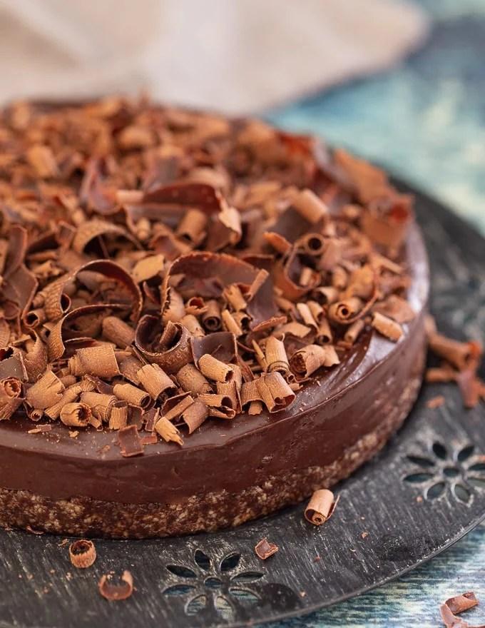No-Bake Espresso Chocolate Fudge Cake on a black decorative plate