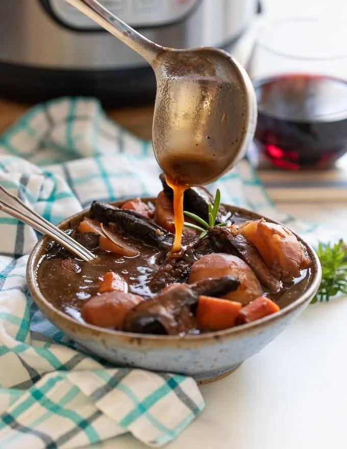 Vegan Instant Pot Portobello Pot Roast being ladled into a bowl