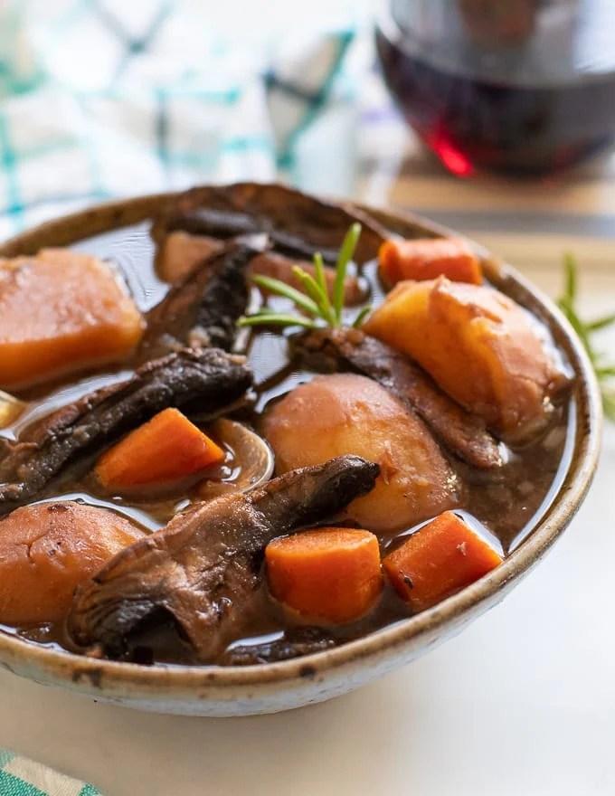 close up shot of Vegan Instant Pot Portobello Pot Roast in a bowl