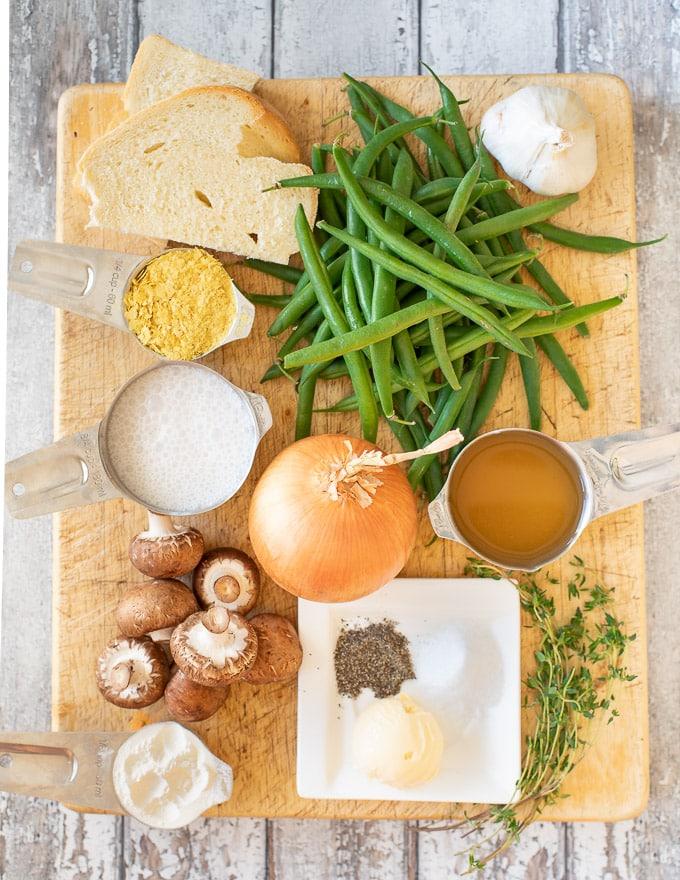 Vegan Green Bean Casserole ingredients on a cutting board