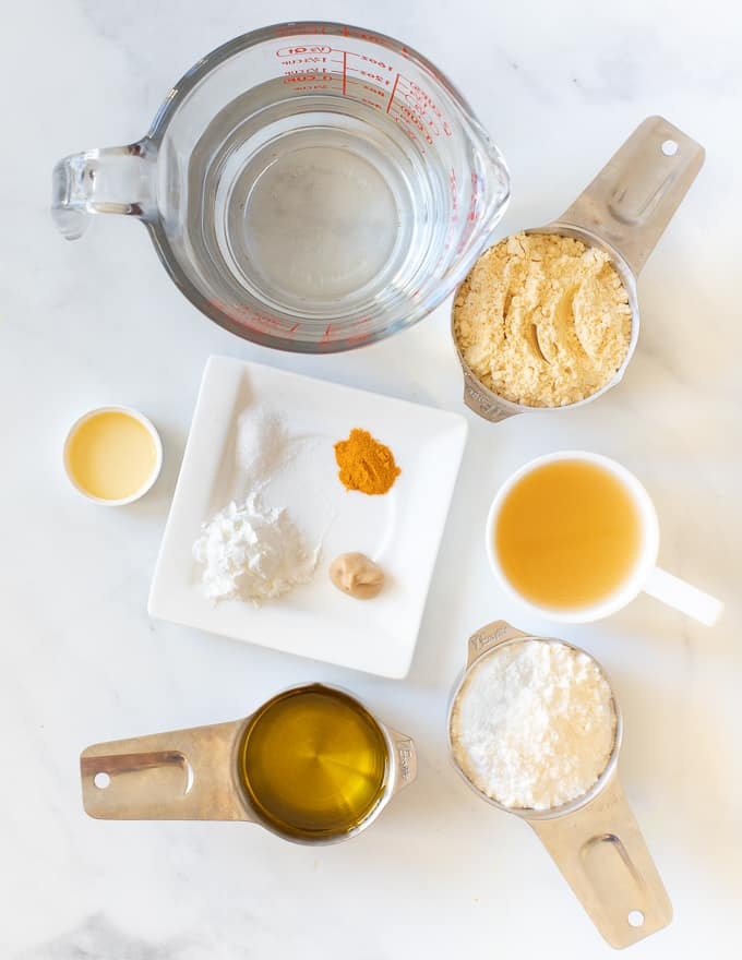 Vegan Yorkshire Pudding ingredients laid out on a white backdrop