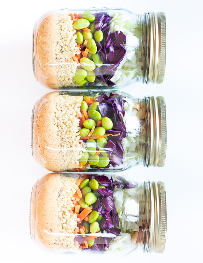 3 layered salads in jars, laid down and taken from above