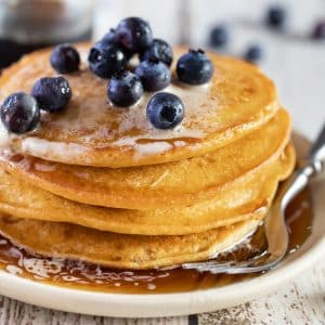 vegan gluten free pancakes with maple syrup and blueberries