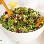 Quinoa Cranberry Salad in a bowl with salad servers