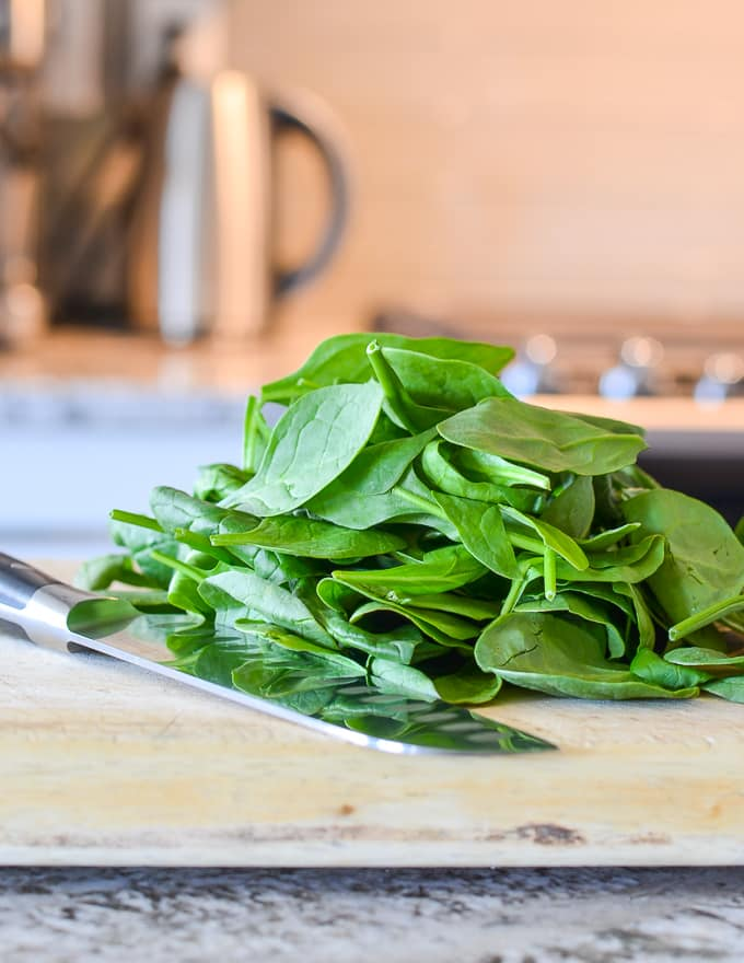 spinach on a cutting board