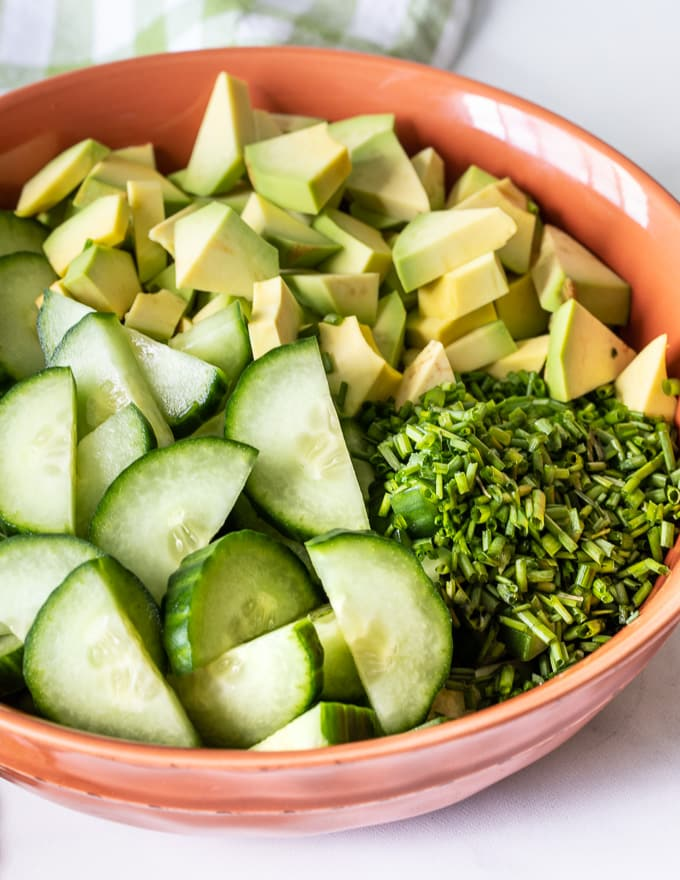 cucumber, avocado and fresh dill in a bowl